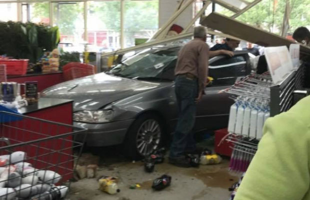 Article image for Ford flies through front window of Reject Shop