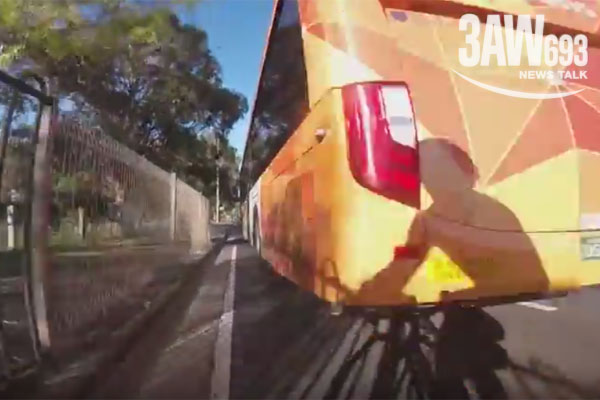 Article image for Video: Cyclist has close encounter with bus