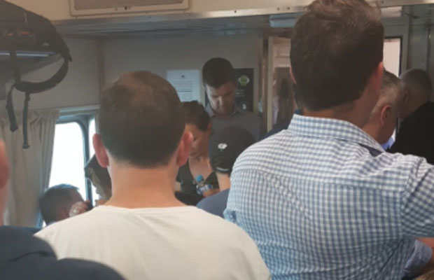 Article image for Commuters suffer in searing heat on packed trains