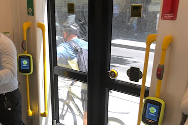 Article image for Tom Elliott snaps cyclist getting a free ride by holding onto tram
