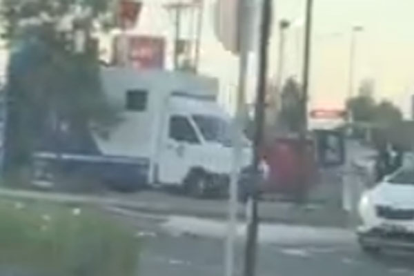 Article image for Video: Young man on top of police van in Melbourne's west