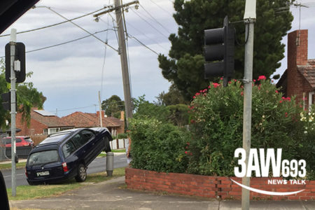 P-plate driver loses control, ends up perched on power pole