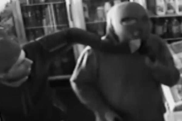 Article image for Video: Milk bar bandit's balaclava troubles don't stop cash heist