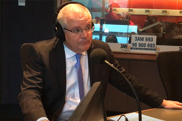 Article image for Slashing immigration won't solve problems, treasurer tells 3AW