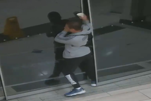 Article image for Bungling bookstore burglar gets backpack stuck in door — while wearing it