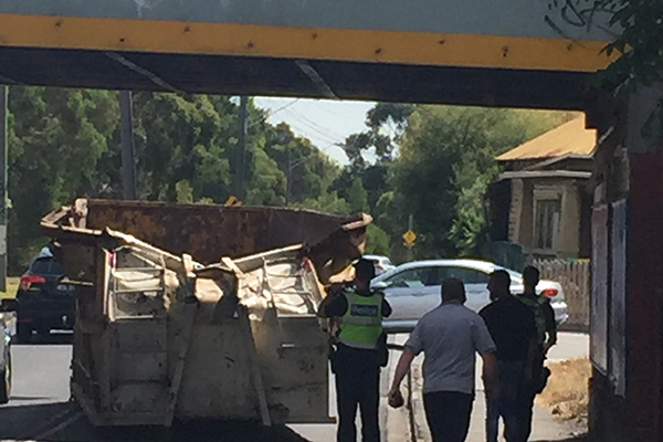 Article image for Truck loses load going under rail bridge in Melbourne's inner north