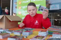 Little boy parts with beloved footy card collection for good cause