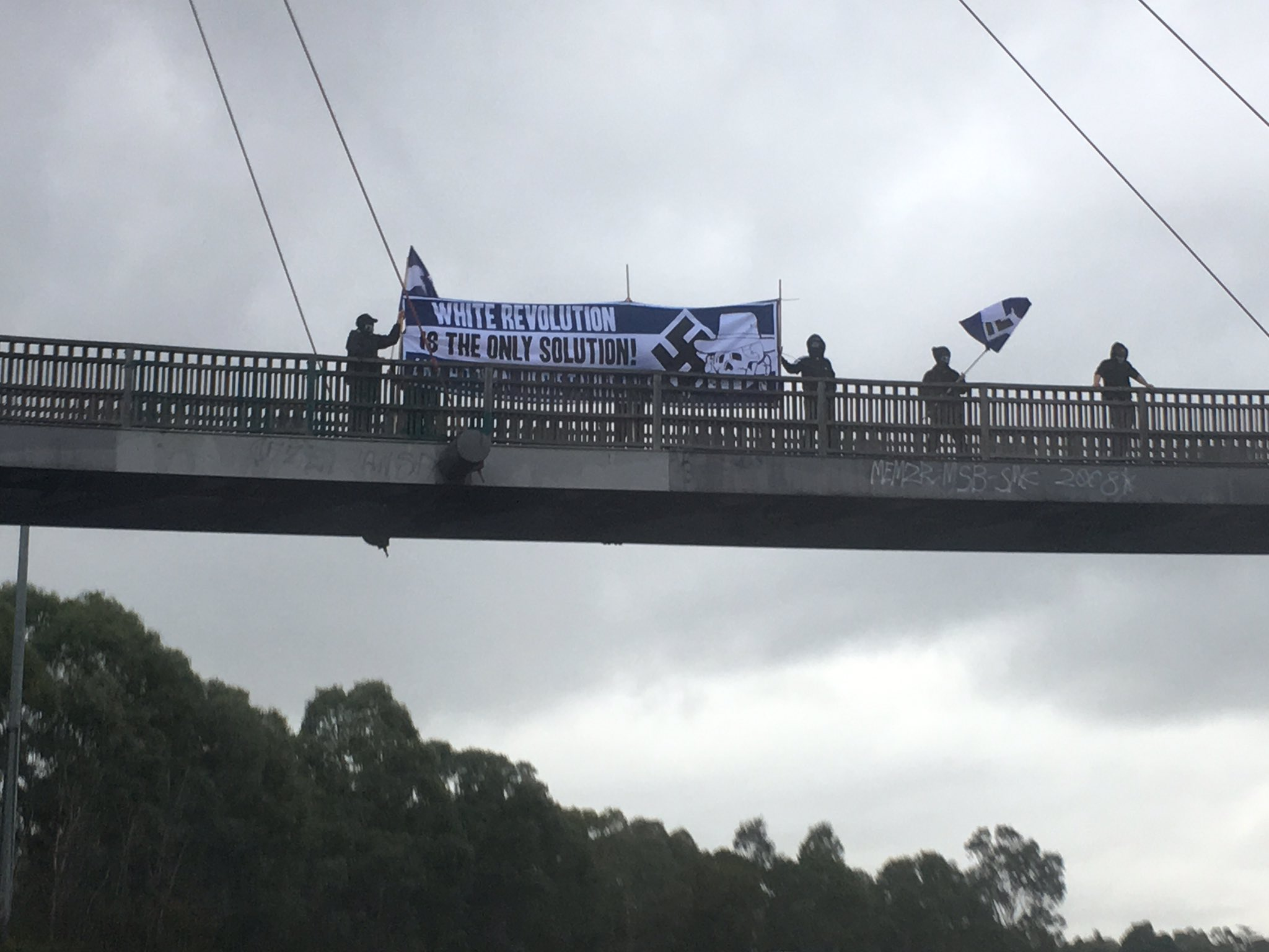Article image for White supremacists hang racist banner over Eastern freeway