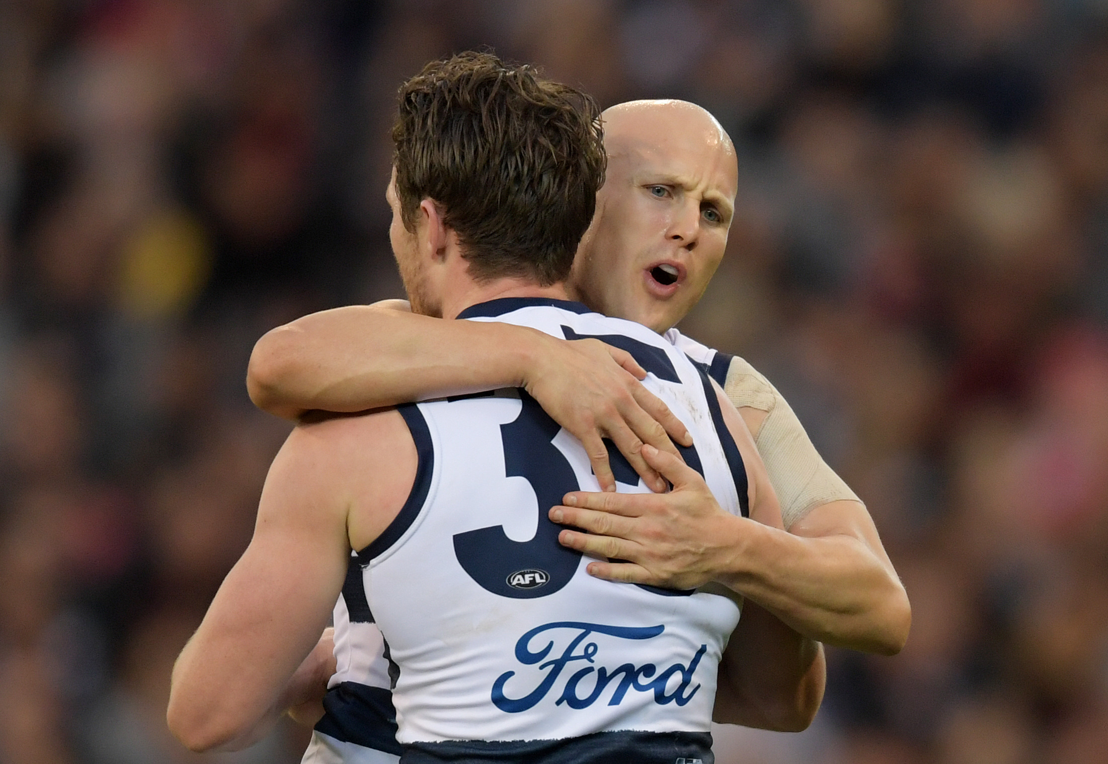 Article image for Geelong holds off North Mebourne challenge to win in Ablett's milestone match