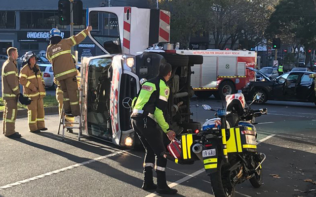 Article image for Ambulance on its side, paramedics in hospital after North Melbourne collision