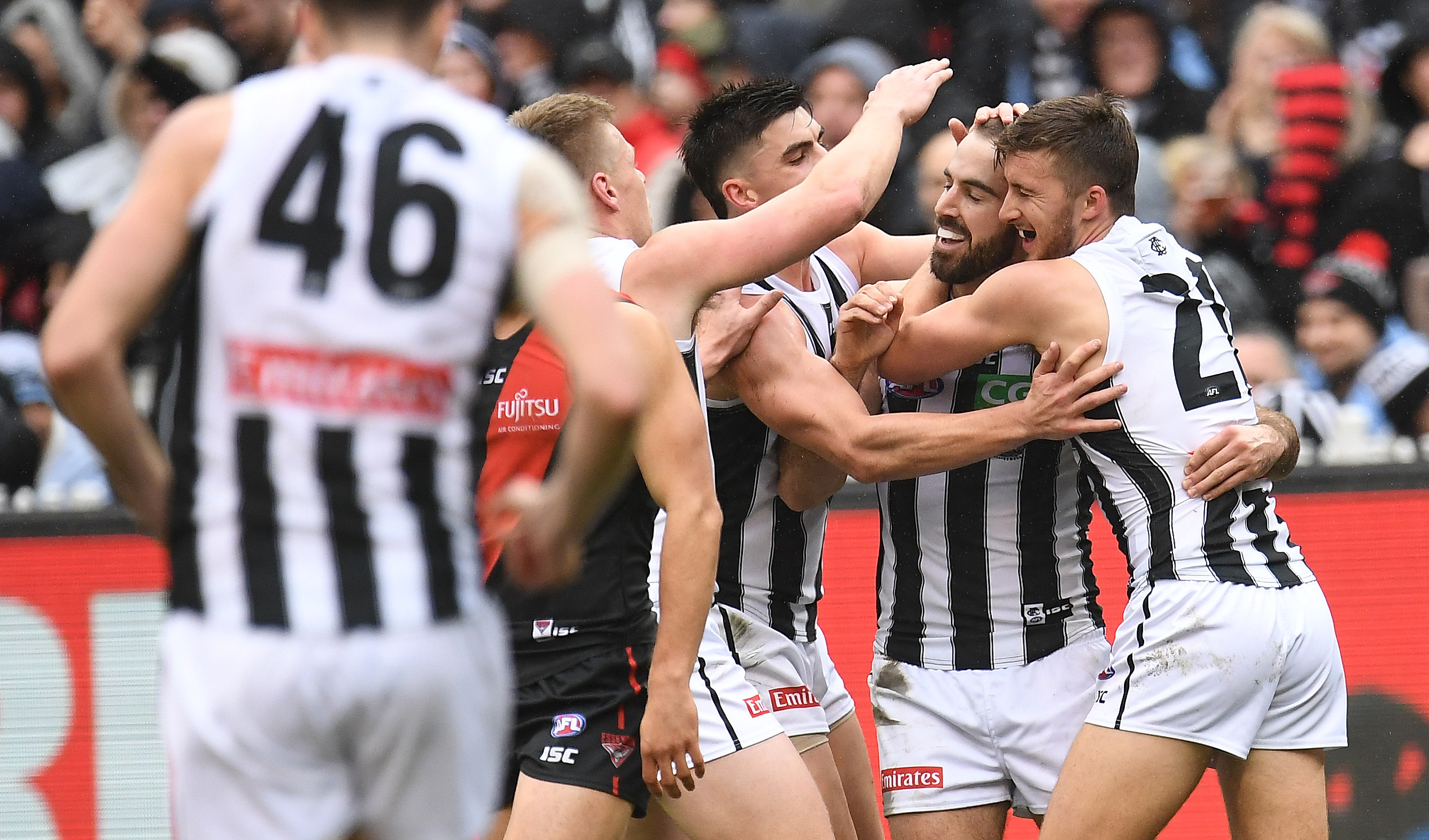 Article image for Collingwood claims victory over Essendon in Sidebottom's milestone game