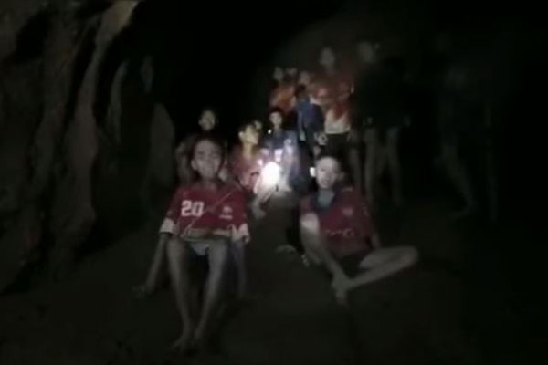 Article image for Scenes of jubilation as missing Thai boys and soccer coach found alive after 9 days in cave