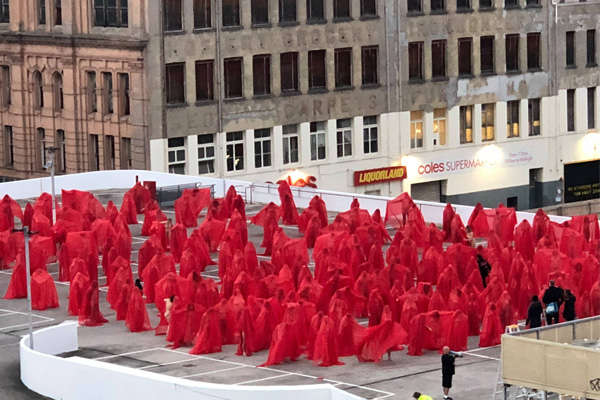 Hundreds don sheer red capes in Spencer Tunick 'apocalyptic' photoshoot