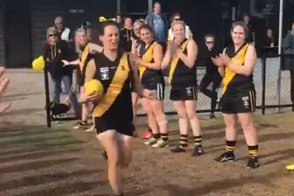 Article image for Video of footy player's 100th game celebration goes viral