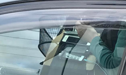 Article image for Driver snapped using multiple phones on busy road