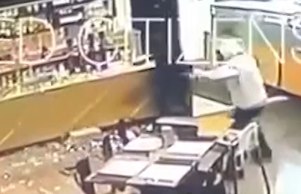 Article image for Video: Pizza shop and bottle store smashed up in terrifying armed robbery