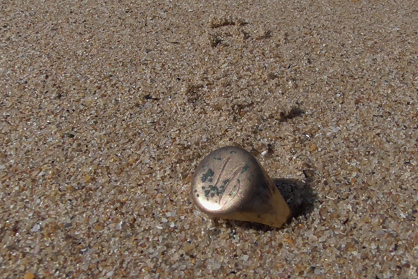 Article image for Dad's lost ring discovered on same beach 25 years later
