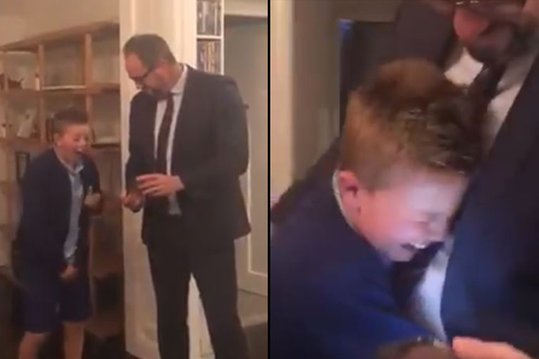 Article image for Little boy reduced to tears as Dad surprises him with Demons finals tickets