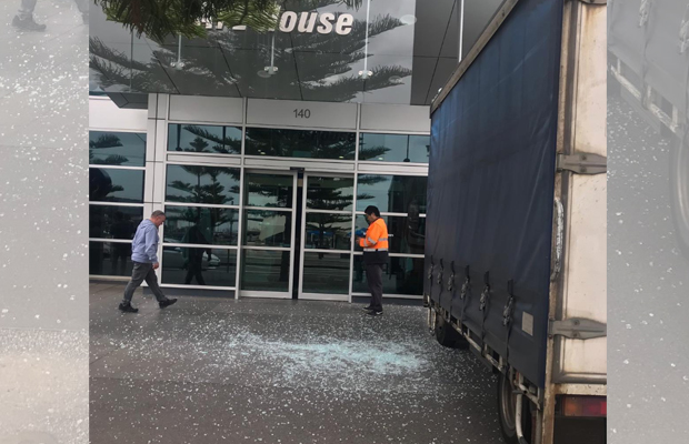 Article image for Truck crashes into front of AFL House