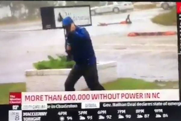Article image for TV weatherman in the US caught out faking battle against gale-force winds