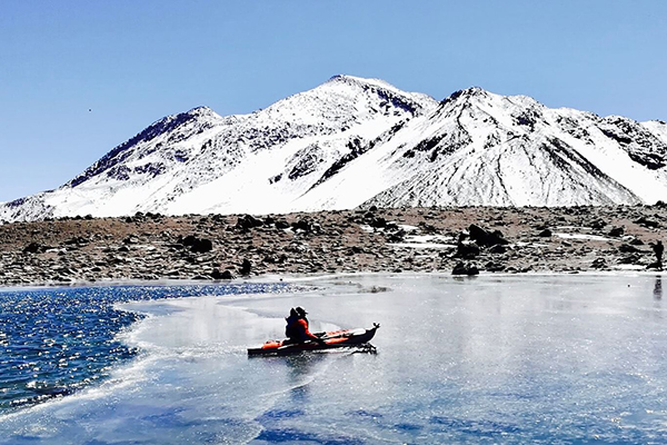 Aussie adventurer's breaking the ice with a new world record on an inflatable kayak near the world's highest volcano