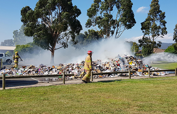 Article image for Rubbish truck catches fire, dumps burning load on the road
