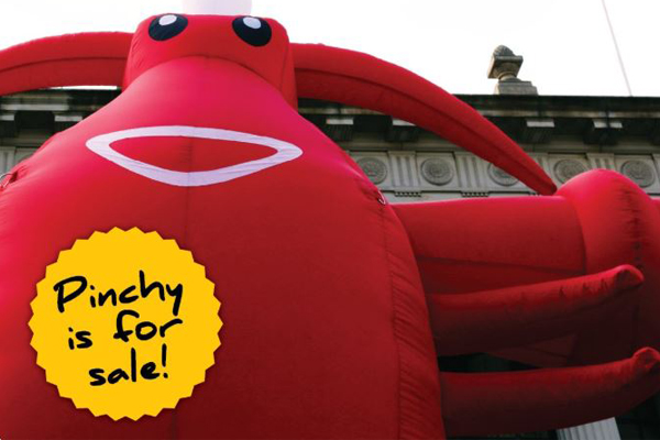 Article image for 'Pinchy' the 4.5 metre inflatable lobster has been put up for sale by Trades Hall