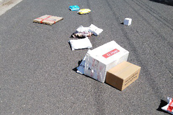Article image for Resident finds 18 parcels scattered across the road in Hoppers Crossing