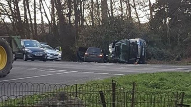 Prince Phillip rolls Land Rover in two-car crash