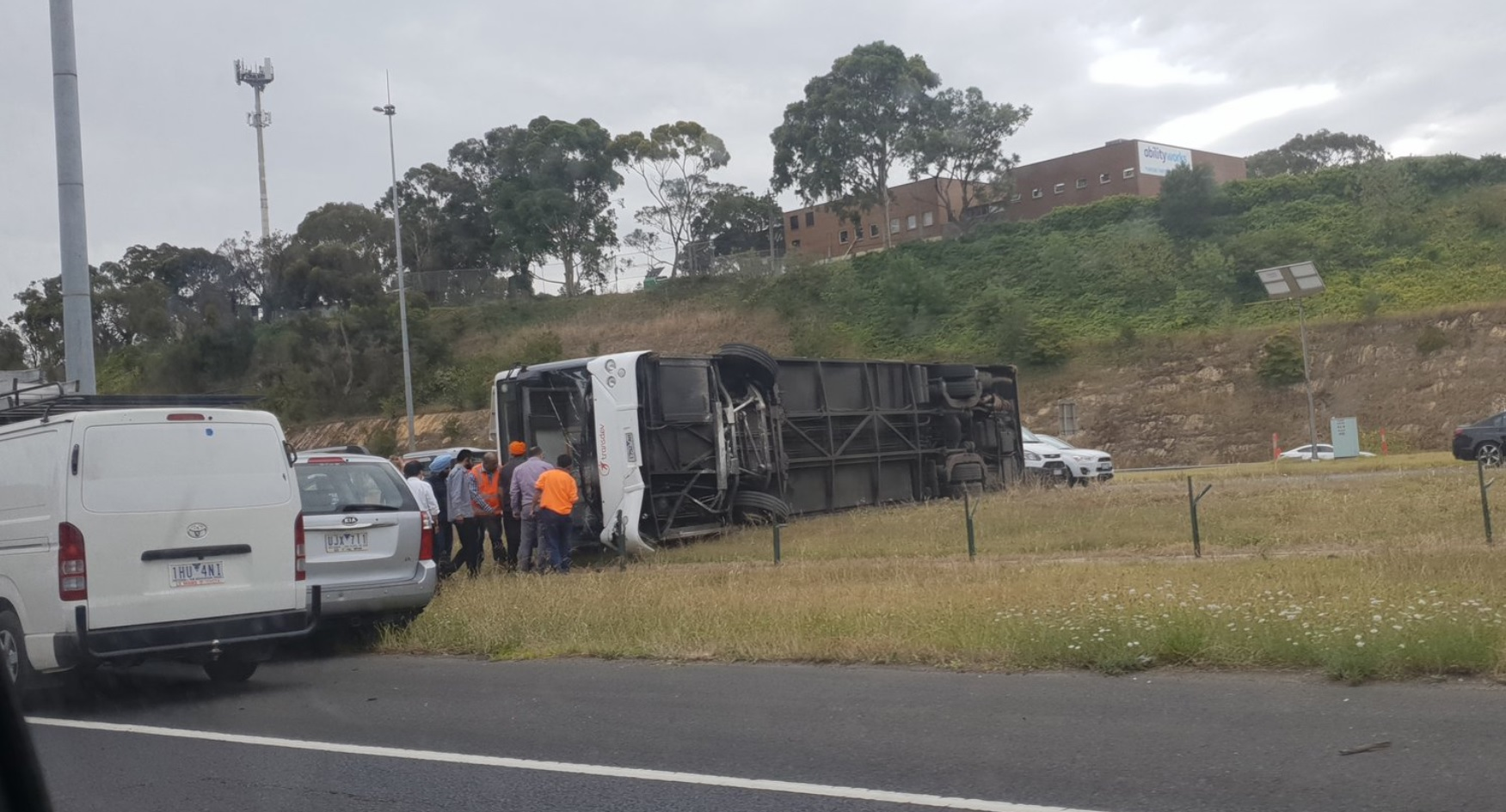 Bus rolls in dramatic fashion on Eastern Freeway