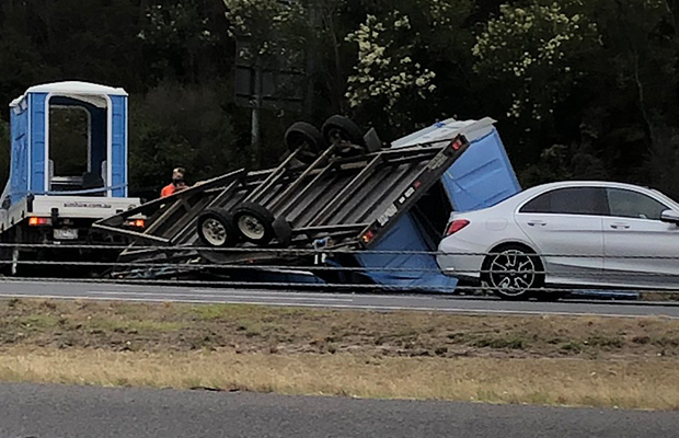 Article image for Truck carrying portaloos tips over on Eastlink