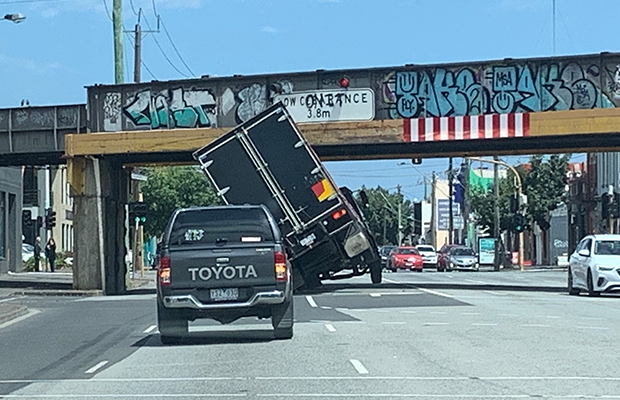 Truck slams into South Melbourne overpass