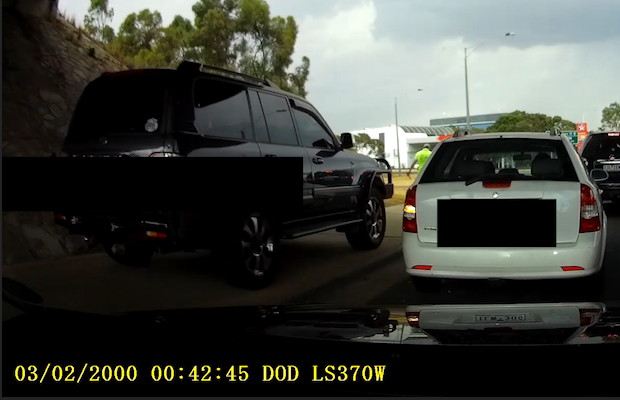Article image for Cheating 4WD driver narrowly avoids pedestrian trying to beat traff