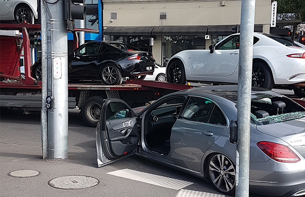 Article image for Flinders St closed after trucks drives 'straight over the top' of luxury car