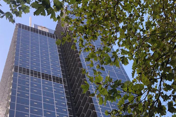 Article image for MFB crews abseiling 45 floors up as sign rips off CBD building in high winds