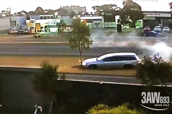 CCTV captures car spinning over busy road and mowing down tree in Melbourne's west