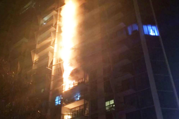 Article image for Docklands residents awarded multimillion-dollar compensation lawsuit after 2014 tower fire
