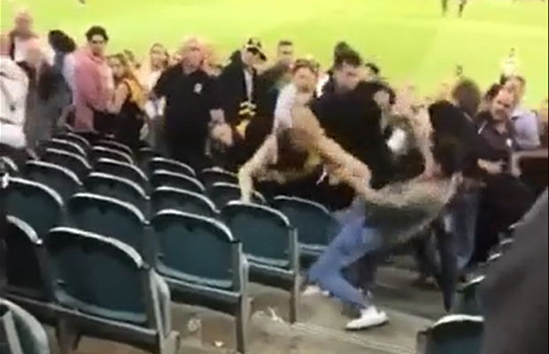 Article image for Footy brawl: Fists fly, teen arrested in the MCG stands