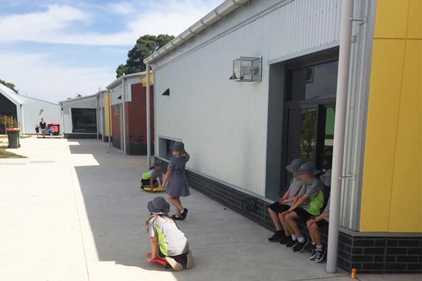 Article image for Kids forced to play in shade of buildings at primary school in Melbourne's outer-north
