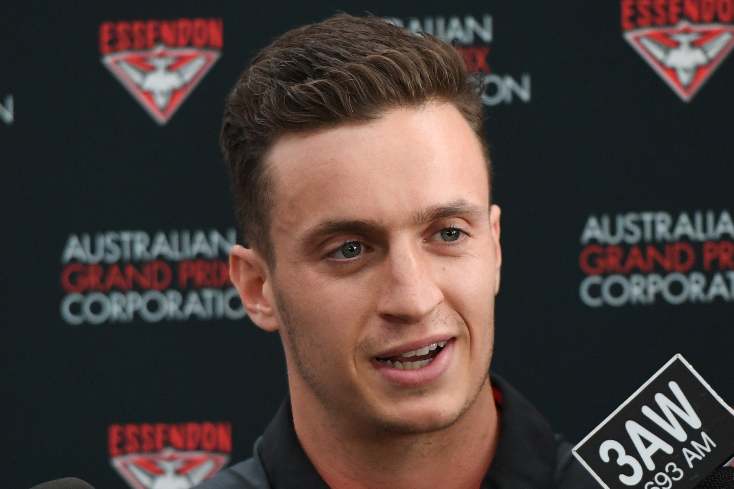Article image for Newsreader says Essendon footballer likely 'just trying to fit in' following pronunciation confusion