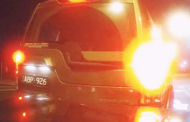 Article image for Video: Driver on the run after brazen cop car ramming