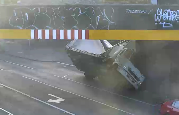 Article image for City Road closed for truck wedged under bridge