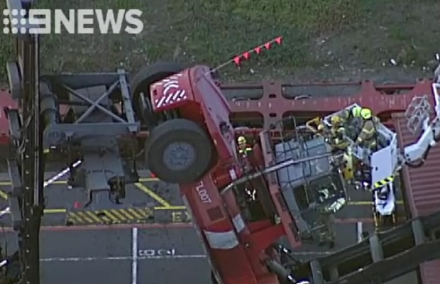 Article image for Worker trapped as container forklift flips at West Melbourne