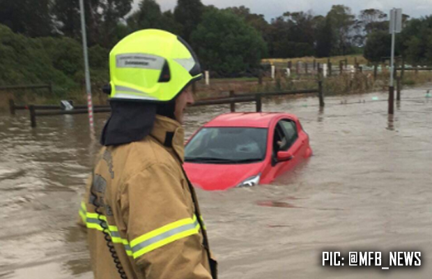 Driver rescued after getting stuck in floodwater