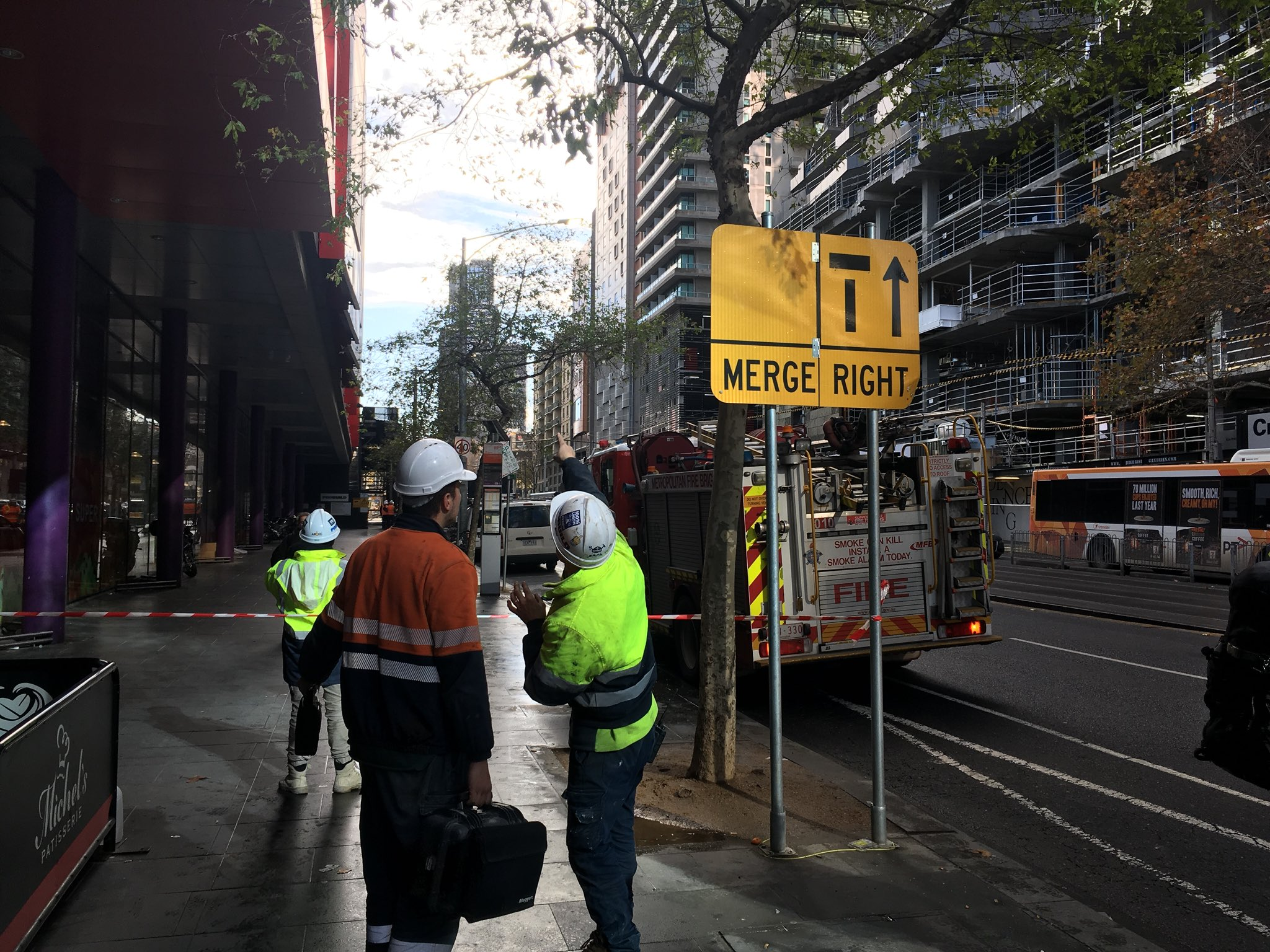 Article image for Broken crane leaves tonnes of glass dangling over CBD