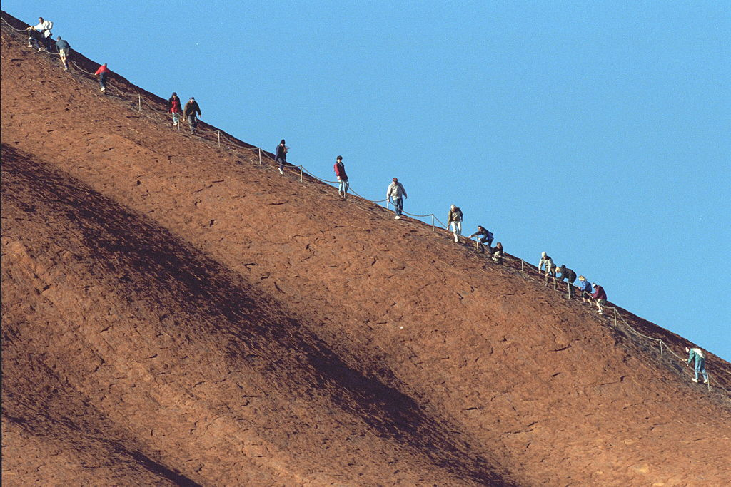 Article image for Tourists flock to Uluru ahead of climb ban, leaving 'serious mess'