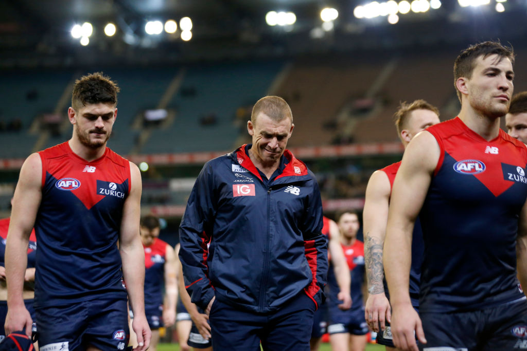 The struggling Swans dismantle the Demons in slippery conditions at the MCG