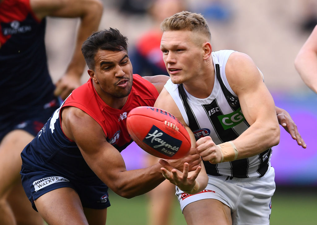 Article image for Pies prevail despite spirited Demons fightback