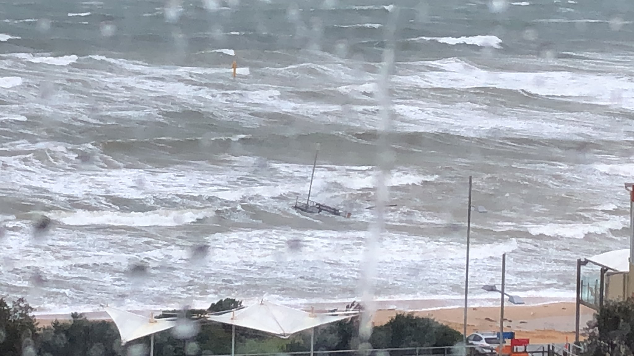 Article image for Wild weather: Frankston Pier snaps, planes grounded and trees down as extreme winds lash the state