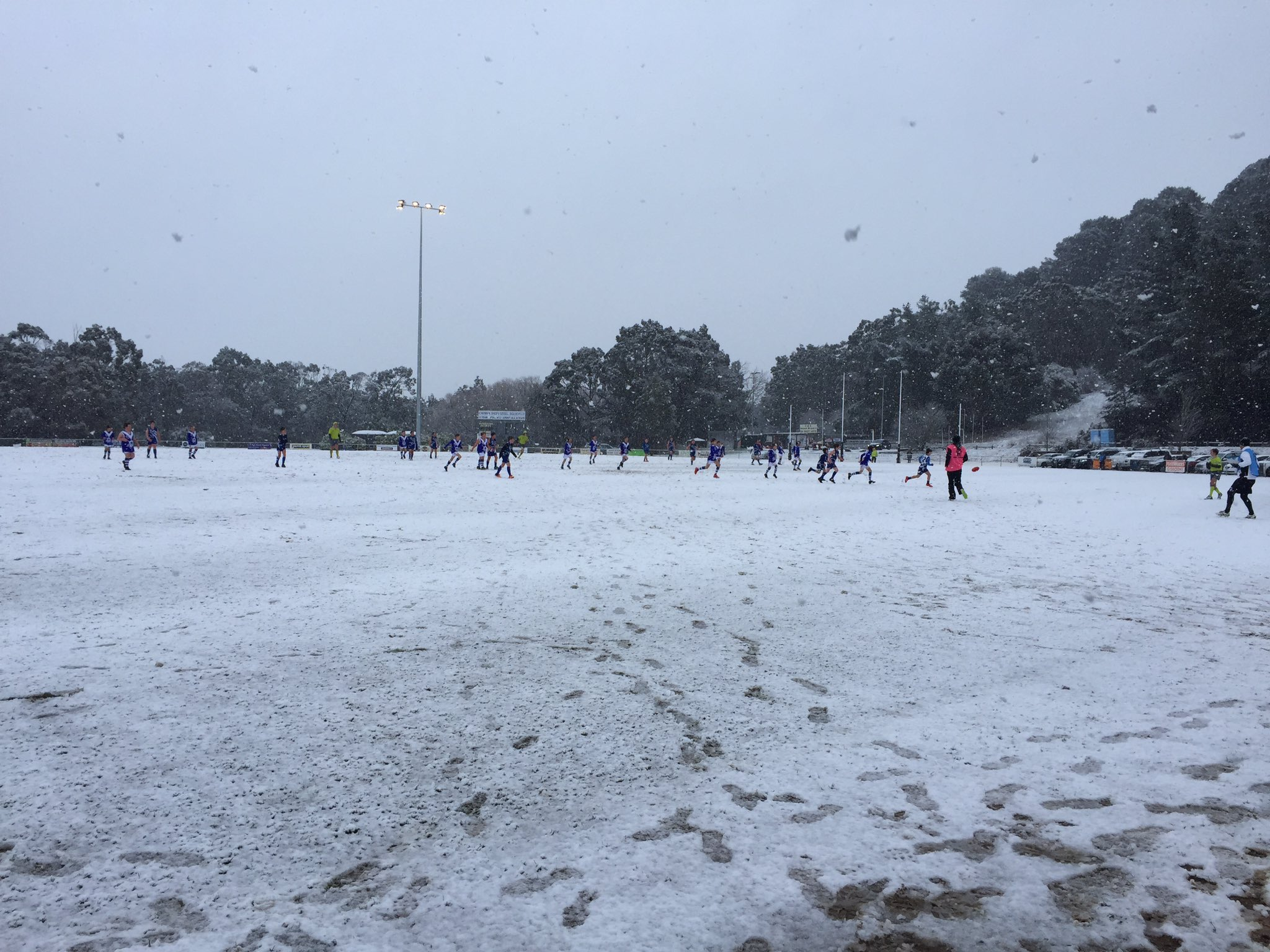 Article image for 'It looks like a skating rink!': Woodend junior footballers play on snow blanketed oval